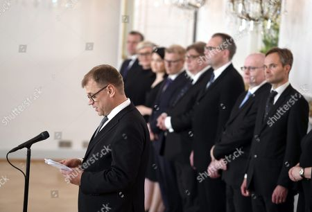 Stock Image of Finnish outgoing Prime Minister Juha Sipila gives a speech as the old government of Finland pays a complimentary farewell visit to the President of Finland at the Presidential Palace