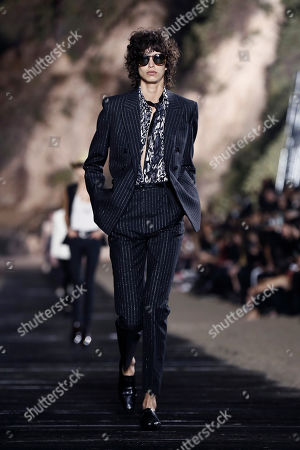 Argentinian model Mica Arganaraz presents a creation from the Spring/Summer 2020 Menswear collection by Belgian designer Anthony Vaccarello for Saint Laurent Paris fashion house in Malibu, California, USA, 06 June 2019.
