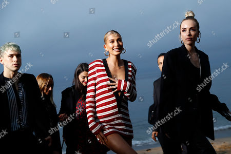 US model Hailey Rhode Bieber (C) arrives to attend the Spring/Summer 2020 Menswear collection show by Belgian designer Anthony Vaccarello for Saint Laurent Paris fashion house in Malibu, California, USA, 06 June 2019.
