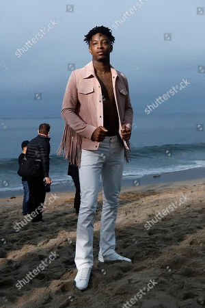US rapper 21 Savage (C) arrives to attend the Spring/Summer 2020 Menswear collection show by Belgian designer Anthony Vaccarello for Saint Laurent Paris fashion house in Malibu, California, USA, 06 June 2019.