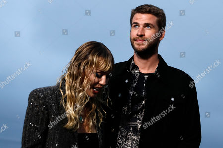 US singer Miley Cyrus (L) and her husband Australian actor Liam Hemsworth (R) arrive to attend the Spring/Summer 2020 Menswear collection show by Belgian designer Anthony Vaccarello for Saint Laurent Paris fashion house in Malibu, California, USA, 06 June 2019.