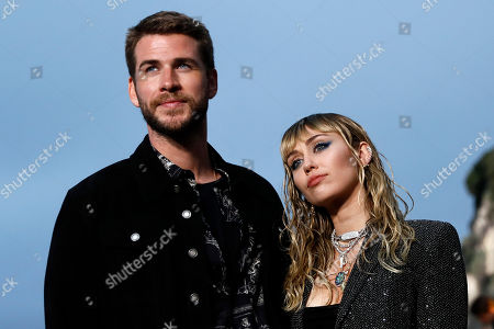 US singer Miley Cyrus (R) and her husband Australian actor Liam Hemsworth (L) arrive to attend the Spring/Summer 2020 Menswear collection show by Belgian designer Anthony Vaccarello for Saint Laurent Paris fashion house in Malibu, California, USA, 06 June 2019.