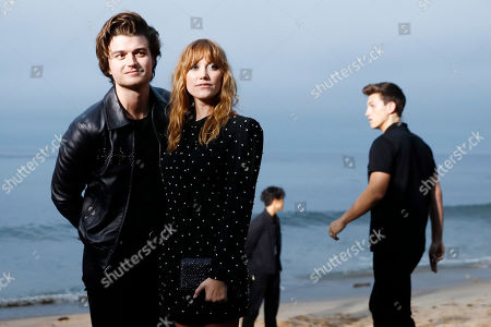 US actor Joe Keery (L) and US actress Maika Monroe arrive to attend the Spring/Summer 2020 Menswear collection show by Belgian designer Anthony Vaccarello for Saint Laurent Paris fashion house, in Malibu, California, USA, 06 June 2020.
