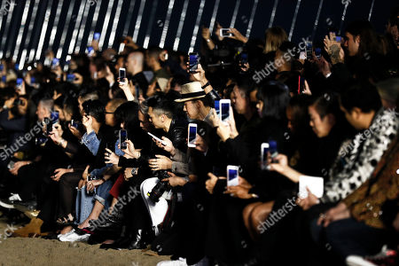 Guests take pictures with their mobiles during the Spring/Summer 2020 Menswear collection show by Belgian designer Anthony Vaccarello for Saint Laurent Paris fashion house, in Malibu, California, USA, 06 June 2020.