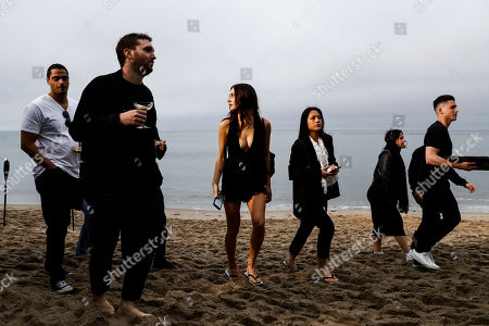 Stock Photo of Guests arrive to attend the Spring/Summer 2020 Menswear collection show by Belgian designer Anthony Vaccarello for Saint Laurent Paris fashion house, in Malibu, California, USA, 06 June 2020.