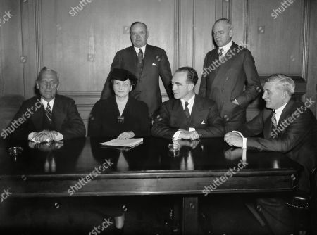 Stock Image of GM executives meet with Sec. Perkins and Gov. Murphy to discuss sit-down strike. Jan. 21, 1937. L-R: Alfred P. Sloan, Jr.; General Motors Pres; Sec. Francis Perkins; Gov. Frank Murphy; and William Knudsen, GM operations. Back Row: John Thomas Smith, left, GM counsel; and Donaldson Brown, GM Finance.