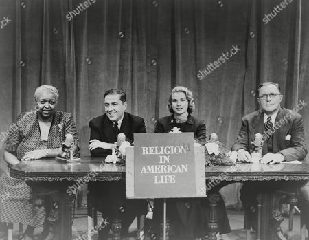 Grace Kelly appears with Ethel Waters, Herman Wouk, and Charles E. Wilson on a panel in a television program of the organization Religion in American Life. 1953. nization Religion in American Life. 1953. bottle. Photo ca. 1947. ld War II.