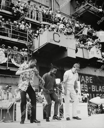 USO entertains troops in Vietnam. The Nicholas Brothers, Fayard and Harold, dance with Bob Hope on the USS Ticonderoga. Dec. 22, 1966.
