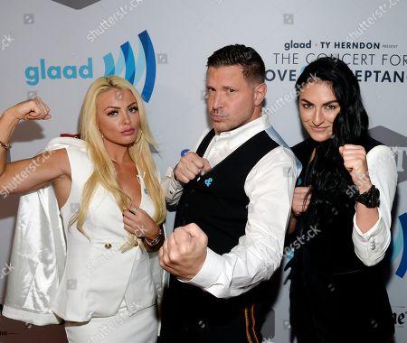 Ty Herndon (center) Joined by WWE Superstars Mandy Rose and Sonya