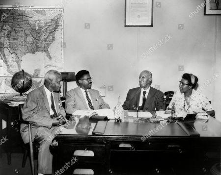 Brotherhood of Sleeping Car Porters group. L-R: Ashley Totten, union official for the Brotherhood of Sleeping Car Porters; an unidentified man; Asa Philip Randolph; and Maida Springer-Kemp, union official for International Packing House workers. 1950s.