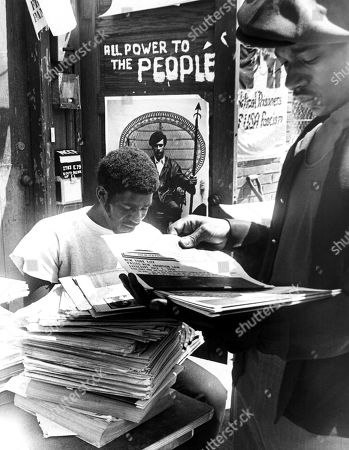 Two members of the Black Panther Party (Cleve Simpson, age 22, and David Hall, age 22) count issues of The Black Panther, July 1970.