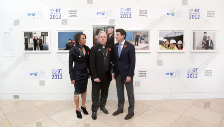 Stock Picture of Dame Kelly Holmes, photographer Brian Griffin and Lord Coe with his new portraits for the BT Road to 2012 Project