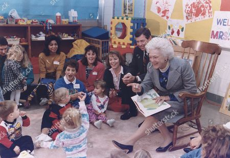 First Lady Barbara Bush and Missouri Governor John Ashcroft attend a Parents as Teachers gathering at a public school in Florissant Missouri where she read BROWN BEAR BROWN BEAR to the children. 1991.