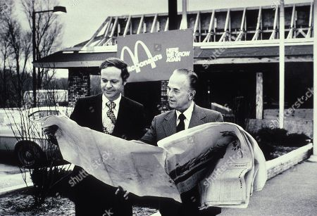 Fred Turner and Ray Kroc the executive leaders of McDonalds Corporation looking at blueprints of future restaurant. McDonalds Corp. photo ca. 1975.,