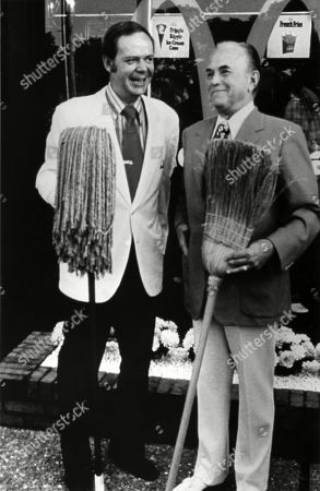 Fred Turner with mop and Roy Kroc with broom at the 2500th McDonalds franchise restaurants at Hickory Hills Illinois in 1973. McDonalds Corp. photo.,