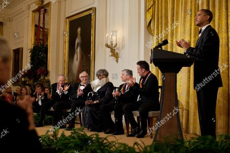 President Obama applauds Kennedy Center Honors recipients in the White House East Room. Seated on stage are Mel Brooks Dave Brubeck Grace Bumbry Robert De Niro and Bruce Springsteen. Dec. 6 2009.,
