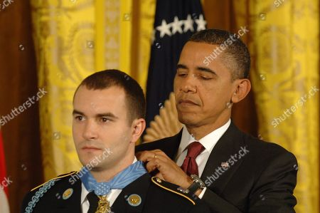 President Obama presents the Medal of Honor to Staff Sergeant Salvatore Giunta for valor and saving the lives of his squad In Afghanistan in 2007. Nov. 16 2010.