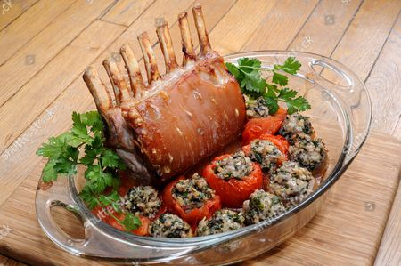 Stock Image of Rack of pork with stuffed tomatoes