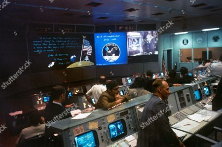 NASA Mission Control during Apollo 11 moon mission. Monitors show President Richard Nixon greeting the astronauts aboard the USS Hornet. July 24, 1969