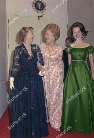 Julie Nixon Eisenhower with her Grandmother-in-law former First Lady Mamie Eisenhower and her mother First Lady Pat Nixon. Ca. 1970.