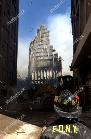 NYC fireman looks up at what remains of the North Tower of the WTC after its collapse. Sept. 13, 2001. World Trade Center, New York City, 2 days after September 11, 2001 terrorist attack. U.S. Navy Photo by Jim Watson