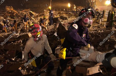 Workers lift rubble and search for survivors. Rescue operations continued into the night at the Ground Zero 7 days after the 9-11 attack on NYC, Sept. 19, 2001. World Trade Center, New York City, after September 11, 2001 terrorist attacks.