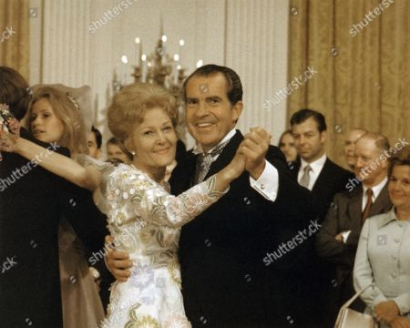 President and Mrs. Nixon dancing at the wedding of Tricia Nixon and Edward Cox. It was the first and last time Nixon danced in public. He was brought up in the Quaker religion, which discouraged dancing. June 12, 1971.