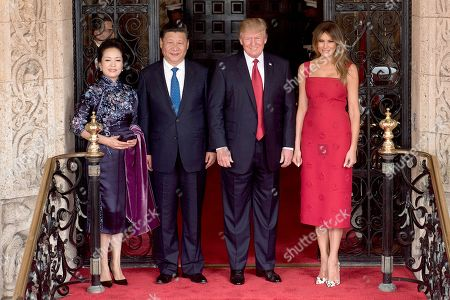 Presidents Donald Trump and Xi Jingping with their wives, Melania Trump and Mrs. Peng Liyuan. Trump and Chinese President Xi had a two-day summit that included discussions over North Korea and trade. On April 6, 2017, they were photographed at the entrance of Mar-a-Lago in Palm Beach, Florida