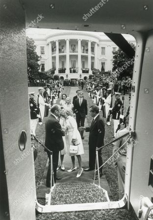 Richard Nixons departure from the White House. The President and First Lady Pat Nixon left Washington for California before the swearing in of President Gerald Ford. Further back are the Nixons daughters, Tricia and Julie with their husbands, Edward Cox and David Eisenhower. Aug. 9, 1974.