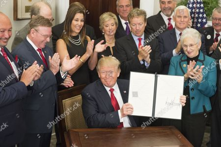 President Donald Trump signs the Executive Order to Promote Healthcare Choice and Competition. Oct. 12, 2017. The order allows American employers to form health insurance groups across state lines