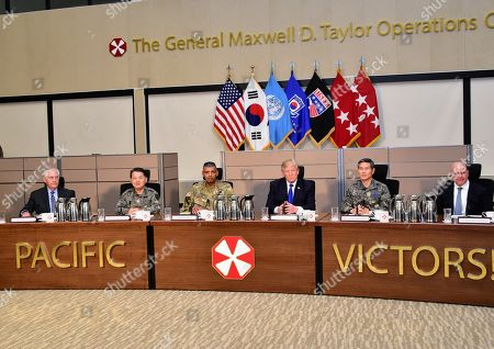 Stock Image of President Donald Trump at a military briefing by US and Republic of Korea military in South Korea. Nov. 7, 2017. L-R: Rex Tillerson, Sec. of State; Gen. Byung Joos; Gen. Vincent Keith Brooks; The President; Gen. Jeong Kyeong-doo; Nat. Sec. Advisor H.R. McMaster