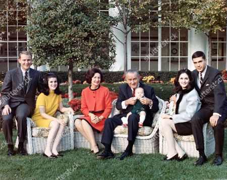 Stock Picture of President LYNDON B.JOHNSON, posing on the lawn of the White House, with his family, Pat & Luci Nugent, Lady Bird, LBJ, Lyn Nugent, Lynda & Chuck Robb, 1967.