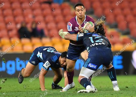 Duncan Paia'aua (centre) of the Reds is tackled by Ma'a Nonu (right) of the Blues during the Round 17 Super Rugby match between the Queensland Reds and the Auckland Blues at Suncorp Stadium in Brisbane, Australia, 07 June 2019.