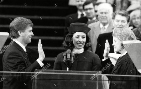 Bush Sr. Presidency. From left: US Vice President Dan Quayle with Marilyn Quayle, being sworn in by Supreme Court Justice Sanda Day OConnor. Back row: former US President Ronald Reagan. Washington, D.C., January 20, 1989.