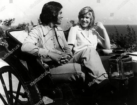 Englebert Humperdinck and Ann Murray take a ride in an old-fashioned buggy in Bermuda. ca. 1974.