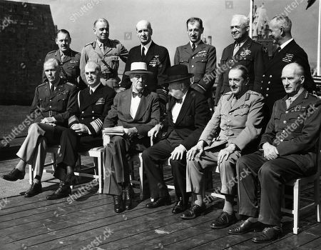 World War II. Seated, from left: George Marshall, William Leahy, Franklin Delano Roosevelt, Winston Churchill, Alan Brooke, John Dill. Standing, from left: Roger Hollis, Hastings Ismay, Ernest King, Charles Portal, Henry Arnold, Andrew Cunningham, at the Second Quebec Conference, (codenamed OCTAGON), Quebec City, Canada, September 1944.
