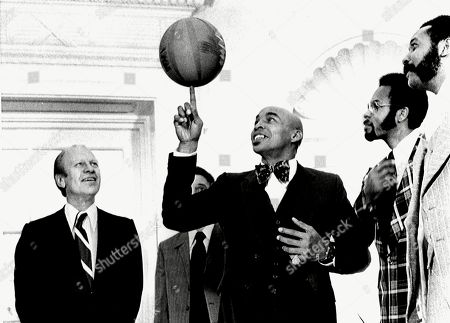 Stock Picture of President Gerald Ford, enjoys a performance by Curly Neal and The Harlem Globetrotters, when they visited The White House, December 6, 1974. .