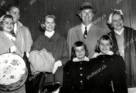 Stock Image of Members of Grace Kellys family, (l to r: Mr and Mrs Donald Levine, Betty Kelly, Mr and Mrs Jack Kelly and nieces Mary Lee Davis and Meg Davis, on their way to attend her wedding to Price Rainier in Monaco. ca. April 1956.
