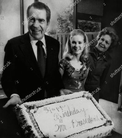 Nixon Presidency. US President Richard Nixon with daughter Tricia Nixon and First Lady Patricia Nixon on Nixons birthday, Washington, D.C., January 9, 1974.