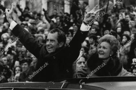 Nixon Presidency. US President Richard Nixon waving the victory sign with First Lady Patricia Nixon, during Inauguration Day, Washington, D.C., January 20, 1973.