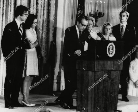 Nixon Presidency. From left: David Eisenhower, Julie Nixon Eisenhower, US President Richard Nixon, First Lady Patricia Nixon, Tricia Nixon Cox, Edward Cox. Nixon addresses his staff shortly before his resignation as President, August 1974.