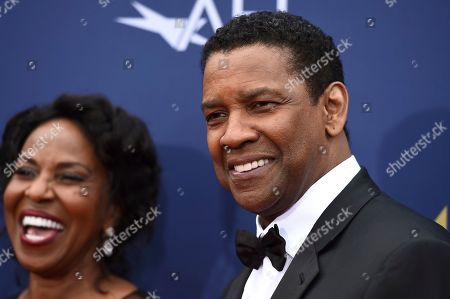 Stock Image of Denzel Washington, Pauletta Washington. Honoree Denzel Washington, right, arrives with Pauletta Washington at the 47th AFI Life Achievement Award at the Dolby Theatre on in Los Angeles