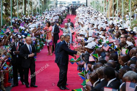 President Barack Obama and First Lady Michelle Obama shake hands with the Tanzanian crowd. President Jakaya Kikwete of Tanzania and First Lady Salma Kikwete join them on the red carpet at the State House in Dar es Salaam, Tanzania. July 1, 2013