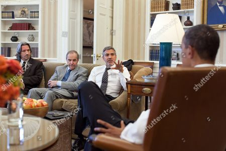 President Barack Obama meets with Human Rights activists in the Oval Office, March 15, 2012. L-R: John Prendergast, Enough Project co-founder; Ambassador Princeton Lyman, the U.S. Special Envoy for Sudan; and George Clooney.