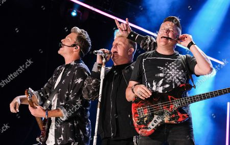 Joe Don Rooney, Gary LeVox and Jay DeMarcus of Rascal Flatts