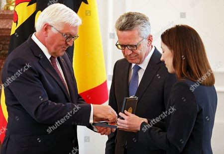 German President Frank-Walter Steinmeier (L) awards the Order of Merit to former German Interior minister Thomas De Maiziere (C) during a ceremony at Bellevue Palace in Berlin, Germany, 07 June 2019. The Order of Merit of the Federal Republic of Germany is awarded by the President to honor achievements of 'particular value to society'.