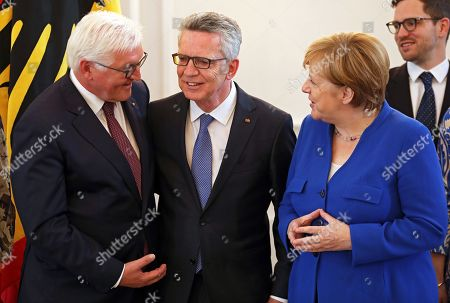 Former German Interior Minister Thomas De Maiziere stands between German President Frank-Walter Steinmeier (L) and German Chancellor Angela Merkel (R) after being awarded with the Order of Merit during a ceremony at Bellevue Palace in Berlin, Germany, 07 June 2019. The Order of Merit of the Federal Republic of Germany is awarded by the President to honor achievements of 'particular value to society'.