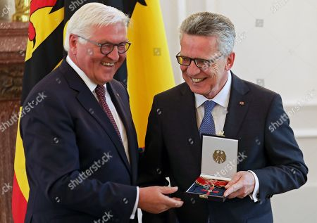 German President Frank-Walter Steinmeier (L) awards the Order of Merit to former German Interior minister Thomas De Maiziere (R) during a ceremony at Bellevue Palace in Berlin, Germany, 07 June 2019. The Order of Merit of the Federal Republic of Germany is awarded by the President to honor achievements of 'particular value to society'.