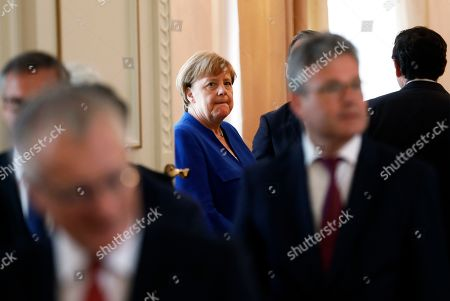 German Chancellor Angela Merkel (C) attends the ceremony of the Order of Merit to former German Interior minister Thomas De Maiziere (unseen) at Bellevue Palace in Berlin, Germany, 07 June 2019. The Order of Merit of the Federal Republic of Germany is awarded by the President to honor achievements of 'particular value to society'.