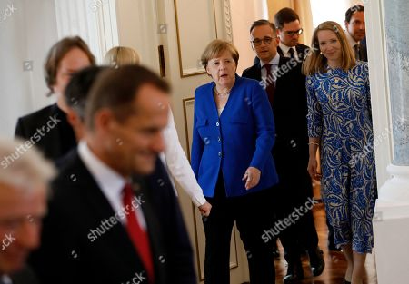 German Chancellor Angela Merkel (C) and German Foreign Minister Heiko Maas (2-R) attend the ceremony of the Order of Merit to former German Interior minister Thomas De Maiziere (unseen) at Bellevue Palace in Berlin, Germany, 07 June 2019. The Order of Merit of the Federal Republic of Germany is awarded by the President to honor achievements of 'particular value to society'.